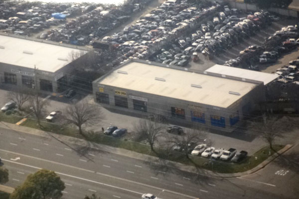 Aerial view of ToyAuto Mart used auto parts store and salvage yard